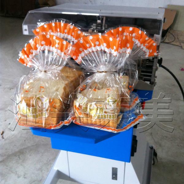 供应韩国小型面包糖果扎花机 扎带机 捆带机自动扎花折扣扇形扎花机 韩国小型面包糖果扇形扎花机