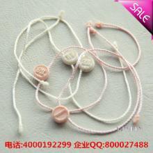 杭州臂章 品牌好的杭州服装吊粒杭州服装吊粒